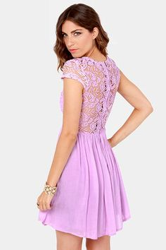 Check it out from Lulus.com! Snag the style that's always the life of the party with the Look the Part-y Lavender Lace Dress! Sheer crochet lace covers the back, cap sleeves, and decolletage, while padded cups form a sultry sweetheart silhouette. A woven full skirt gathers at the waist, then flares for a fit and flare style that is perfect for twirling. Exposed back zipper/hook clasp. Lined. Model is wearing a size small. 65�0Polyester, 35�0Viscose. Dry Clean Only. Imported.