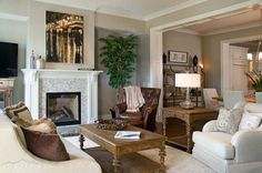 Luxury condominium with agreeable gray Sherwin Williams wall paint living room combined with vent glass fireplace and brown tufted wingback chair also pull chain bronze table lamp