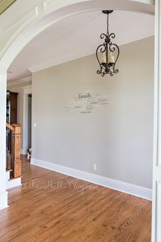 Foyer with Behr Sculptor Clay and Silky White Trim -A BM Revere Pewter Alternative - Behr Sculptor Clay #greige #neutral #paint