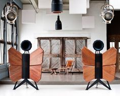 Monarch Two-Way Speakers by OMA: The 'butterfly wings' are wooden baffles designed to amplify the low frequency blasts from the woofers concealed   inside the cabinet — the baffles ensure the bass radiates through the room.  OMA (Oswald's Mill Audio) claims the horn-shaped loudspeaker on top offers levels of sonic purity that a century of audio engineering can't match.