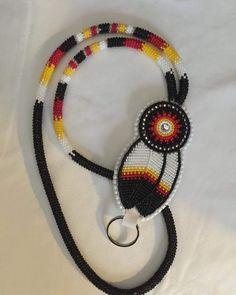 Another cool custom order. #beadwork #beadedfeather #beadedlanyard #beadedkeychain #yxe