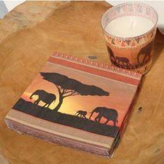 """Sold out. Safari Set Set Safari existing of 20 paper napkins and a candle of """"Colourful life"""" with a beautiful African image and Ganesha incense (50 sticks)."""