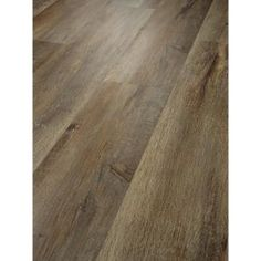 Add depth and personality to your residence by choosing this Shaw Alliant Trail Resilient Vinyl Plank Flooring. Can be installed over both concrete subfloors. Luxury Vinyl Flooring, Vinyl Plank Flooring, Luxury Vinyl Plank, Lifeproof Vinyl Flooring, Champagne Beach, Vinyl Style, Beach Wood, Waterproof Flooring, Wood Vinyl