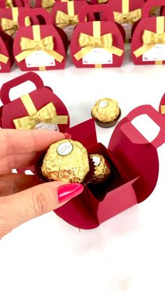 Burgundy wedding favor box with gold satin ribbon bow and custom names, Elegant personalized bonbonniere make a unique way to thank guests for attending your special day. #welcomebox #giftbox #personalizedgifts #weddingfavor #weddingbox #weddingfavorideas #bonbonniere #weddingparty #sweetlove #favorboxes #candybox #elegantwedding #partyfavor #redwedding #burgundywedding #giftboxes #uniqueweddingfavors #uniqueweddingideas #goldwedding Handmade Wedding Favours, Candy Wedding Favors, Wedding Favor Boxes, Wedding Gifts, Wedding Door Hangers, Wedding Doors, Destination Wedding Welcome Bag, Wedding Welcome Bags, Burgundy Wedding