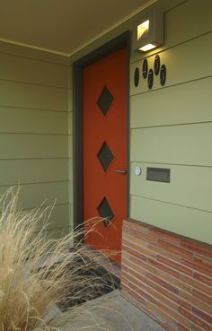 love the retro mid century door...I remember seeing houses like this when I was little.