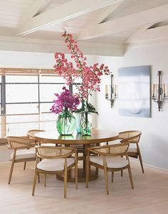"""A Beachy Dining Room - love love love everything about this!    Barrett designed the 1950s-style dining room table and chairs; she caned the chairs and made a see-through table base to give the furniture a """"beachy"""" feel. Chair fabric is ClassicCloth's Gladestone."""