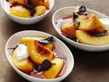 Opal Basil-Macerated Peaches    Ingredients  4firm-ripe peaches, peeled, pitted and quartered  1ounce opal basil leaves (about 2 cupsloosely packed)  1teaspoon grated lime zest  1cup sugar  Creme fraeche, for serving (optional)
