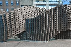 """Brick pattern of """"Pike Loop"""" in Manhattan, NY - photo by Alan Tansey, via Gramazio Kohler;  an over-and-under brick wall installation was built by a robot programmed by Gramazio Kohler to do all the work     http://gramaziokohler.arch.ethz.ch/web/d/forschung/159.html"""