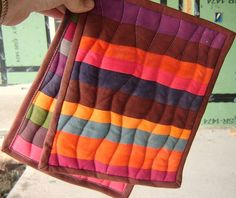 Super easy Hot Pads are mini-quilts.  Hot Pad Tutorial 1 by mamabyrd12, via Flickr