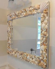 "(Pretty DIY Shell Mirror)  AKA the ""What to do with all those beautiful shells my son and I gather at the beach"" mirror!  <3"