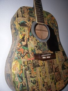 Jamming out! .  Make a guitar in under 120 minutes by decoupaging with decoupage glue, comic, and guitar. Inspired by comic books. Creation posted by Courtney. Difficulty: Simple. Cost: Absolutley free.