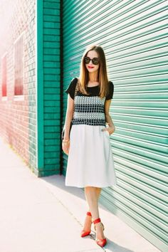 Mara of M Loves M is wearing a Greylin top, a Nordstrom skirt, Zara shoes and Karen Walker sunglasses.