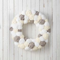 Add unique, homemade flair to the holidays with a festive pompom wreath that's so much fun to make. Bernat Pipsqueak helps you achieve fluffy pompoms. Pom Pom Crafts, Yarn Crafts, Bead Crafts, Kids Crafts, Pom Pom Wreath, Diy Wreath, Wreath Making, Tulle Wreath, Burlap Wreaths