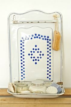 A gorgeous early 1900s vintage kitchen utensil rack, porte louche, from France. White enamelware with lovely bright cobalt blue design. Two holes at top ready to for hanging. Some enamel loss which gives a beautiful rustic patina. It has a bar across the top where utensils were hung from.     Use in the kitchen to hang a tea towel on, or it would look wonderful in a bathroom, holding a hand towel and toiletries in the rack underneath. Très magnifique! 45cm x 30cm