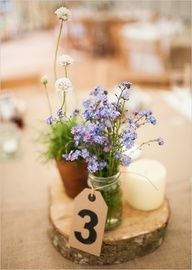 rustic wildflower centerpiece Country Garden Wedding Ideas