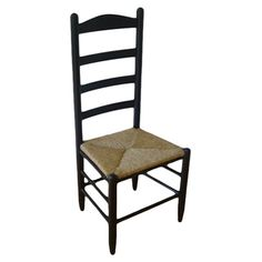Equally at home in a rustic city loft or farmhouse-chic abode, this handcrafted wood side chair showcases a Shaker-inspired ladder-back and hand-woven rush s...