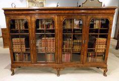 A Beautiful walnut Queen Anne Revival four door bookcase.