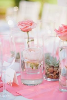 This wedding might just feature my all time favorite floral detail for any wedding, ever. That ceremony backdrop with the coral ombré flowers seeming to grow right out of the wood is amazing, but I shouldn't be surprised with Butterfly