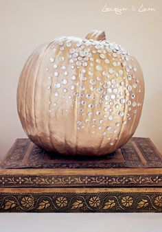 Gold-painted pumpkin with rhinestones