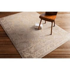 Meticulously woven from acrylic chen in Turkey this rug features a traditional design with a thin high/low pile. This rug will add dimension and style to any space.