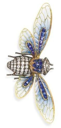 A superb enamel and gem-set Cicada brooch, by Boucheron. The wings of green and blue plique-á-jour enamel with calibré-cut sapphire detail to the old-cut diamond set body and eyes of chrysoberyl cats-eye, mounted in silver and gold, circa 1890.: