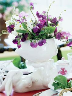Rabbits and Flowers  -- pansies and Johnny jump-ups would be cute in any sweet vase or teacup