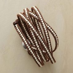 """SILVERSTREAM 5 WRAP BRACELET - Sterling silver nuggets line up on this leather wrap bracelet by artist Chan Luu. Wrap it to your whim and wear it with everything. Sterling silver button closure. 32"""" to 34""""L."""