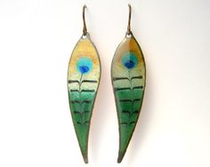 Peacock Feather Earrings- copper enamel earrings with niobium earring hooks, handmade enamel jewelry on Etsy, $26.49. This is done by scrolling a red hot rod through the molten glass. Would love to see a video.