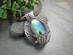 I bezel set this Labradorite cab in fine silver and placed a turtle right on the edge. It is supposed to look like he is about to jump into a pool.