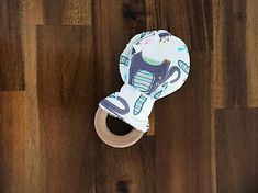 Wooden Teething Ring - Cotton Bunny Ears - Blue, Green and Grey Splash Elephants Wooden Teething Ring, Baby Accessories, Elephants, Green And Grey, Ears, Bunny, Boutique, Trending Outfits, Unique Jewelry