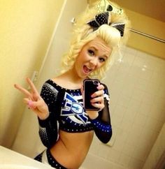 The fiercest cheer hair.one of the reasons I love comp Cute Cheer Bows, Cheer Mom, Cheer Hair Poof, Cheer Makeup, Madison Style, Sport Hair, All Star Cheer, Costumes For Teens, Big Hair