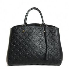 dda0850f0f06 This chic tote is crafted of Louis Vuitton monogram embossed leather in  black. The bag features rolled leather top handles ...