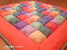 Bubble Quilt Puff Quilt for Baby Floor Time Tummy Time Mat CORAL TEAL PURPLE by LuvinKatie on Etsy https://www.etsy.com/listing/205049264/bubble-quilt-puff-quilt-for-baby-floor