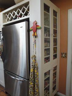 Cabinet next to fridge