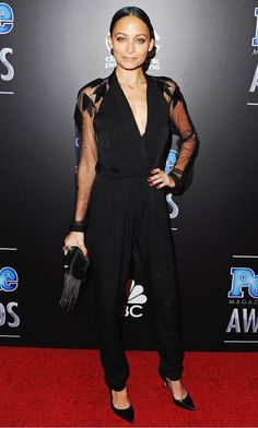 Nicole Richie knows how to style her petite frame in a low-cut black jumpsuit with embellished sleeves