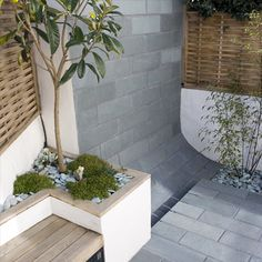 Gorgeous grey tiles, the built in bench is fabulous with the fence