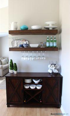 Wine rack under floating shelves in kitchen/dining area