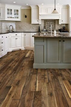 Kitchen pallet:  White cabinets, gray/tan tile back splash, colored island, wood flooring.  Counter tops to be decided.