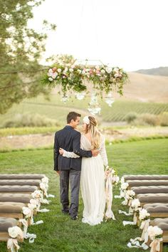 Floral Crystal Chandelier for an Outdoor Wedding Ceremony | Mike Larson Photography | http://heyweddinglady.com/vintage-winery-wedding-shoot-champagne-gold/