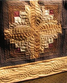 Log Cabin quilt by Shari R; machine quilting design by Cindy Roth for IMQA