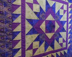Heirloom quilted table topper, table runner, lap quilt or wall hanging in blue, purple and green, peacock feather borders