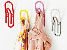 These whimsical paper clip hooks ($9 each) hold up to 20 lbs., so they'll safely support book-filled backpacks.