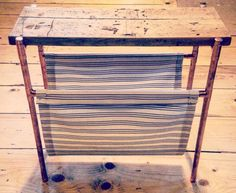Lovely side table with added magazine holder made out of Cotton, Copper piping and reclaimed victorian floorboards.