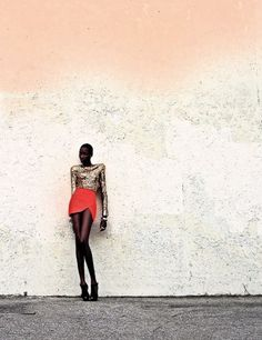 Loooove this photo. The styling blends so well with the simplicity of the background. The model is, well, uber-fierce.