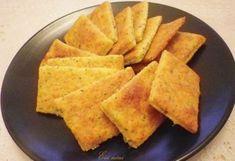 Burgonyás-parmezános keksz recept képpel. Hozzávalók és az elkészítés részletes leírása. A burgonyás-parmezános keksz elkészítési ideje: 20 perc