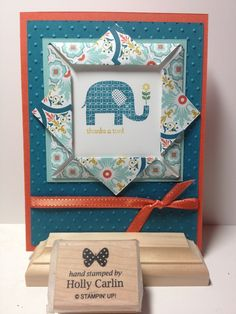 Love this little card with the double-sided paper turned back to show the coordinating design and a peek-a-boo stamped image.
