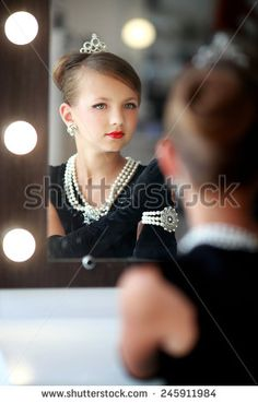 Young lady near the mirror - stock photo