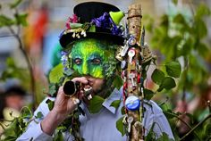 A performer with the Hal-an-Tow pageant blows his horn as part of the Helston Flora Day celebrations  in Cornwall on May 8, 2013. The annual event is one of the UKs oldest customs, celebrating the passing of Winter and the arrival of Spring. (Photo by Matt Cardy/Getty Images)