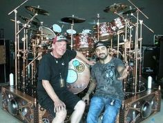 Neil Peart (Rush) & Mike Portnoy (Dream Theater)  This is like putting Buddy Rich and Gene Krupa together.  The two best.....
