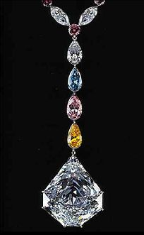 This very unusual 7-sided diamond is known as the Paragon, and weighs 137.82 carats. The Graff Diamond Co. of London cut the gem, and is its current owner. The necklace has a diamond carat weight of 190.27 carats, and separates to both necklace and bracelet lengths. The piece features Fancy Intense blue, yellow and pink diamonds along with the Paragon Diamond, a 137.82-carat D-color Flawless diamond, evolved unmistakably into Graff's creation for the Millennium